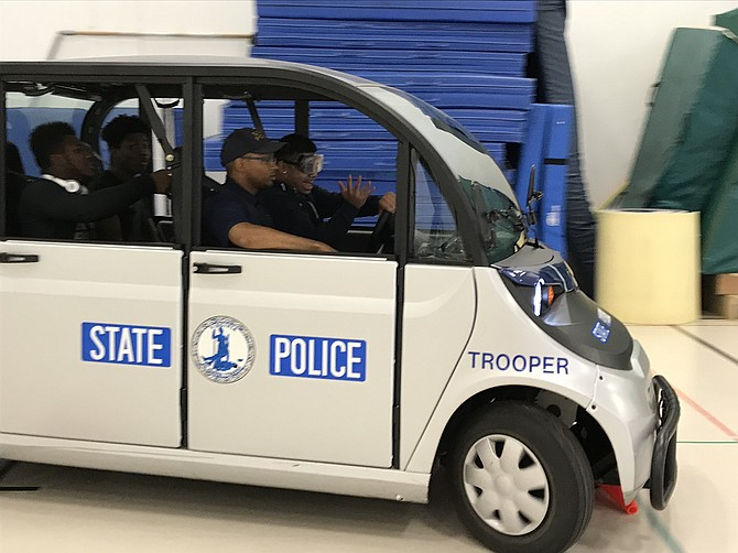 A student at South County loses control of the wheel while driving over a cone on a golf cart for Virginia State Police distracted driving program.