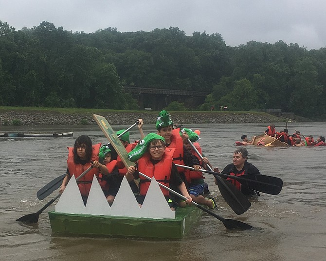 The Navigators sported alligator hats on the water as they landed on the beach.