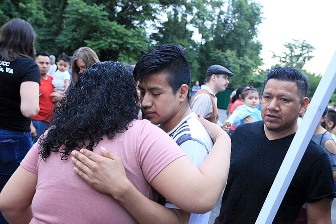 Yosimar Morales, the boyfriend of Claudia Patricia Gómez González, hugs a woman at a candlelight vigil held at Tenants and Workers United in Alexandria, May 30. González, who traveled from Guatemala to live with Morales, was shot and killed on May 23 by a U.S. Border Patrol Agent in Rio Bravo, Texas.