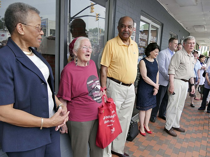 Greg Embree, member of Cherrydale 125 Committee, is joined by Ethelene Crockett Jones, Joan Trumpauer Mulholland, and Dion Diamond, all three participants in the June 9 1960 lunch counter sit-in in Cherrydale. On the right behind Embree are state Sen. Barbara Favola and Del. Patrick Hope.