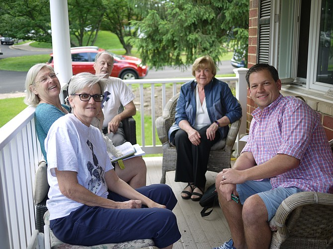 Ohio Street neighbors gather to discuss action to prevent removal of dawn redwood. From left are Angela Dickey, Kit Norland, John Wingard, Mary Glass, and Todd Murdock.