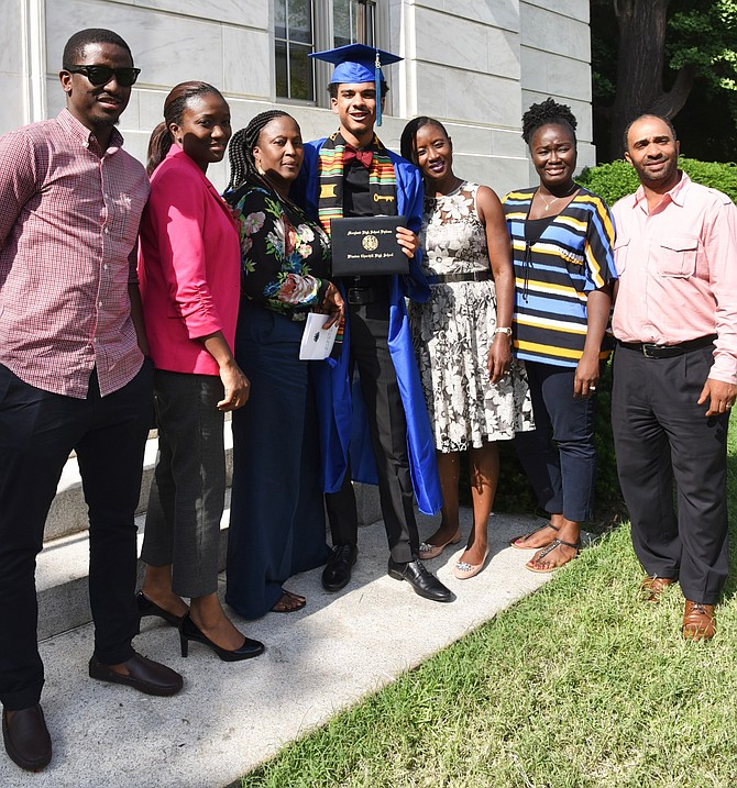 Umar Sanusi, Adama Kanu, Henncia Williams, Mar Jamal Jaffa, Banaru Smith, Abdul Sasso, and Phebean Williams at Churchill High School's graduation on Wednesday, June 6.