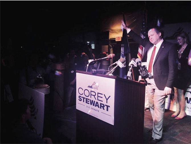 "Prince William County Board of Supervisors Chairman Corey Stewart claims victory during a victory party in Woodbridge, where supporters chanted ""build the wall"" and ""lock her up."""