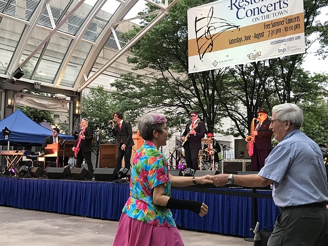 Dancers rock to Blues Beatles during the June 9, Reston Concerts on the Town held at the Pavilion, Reston Town Center.