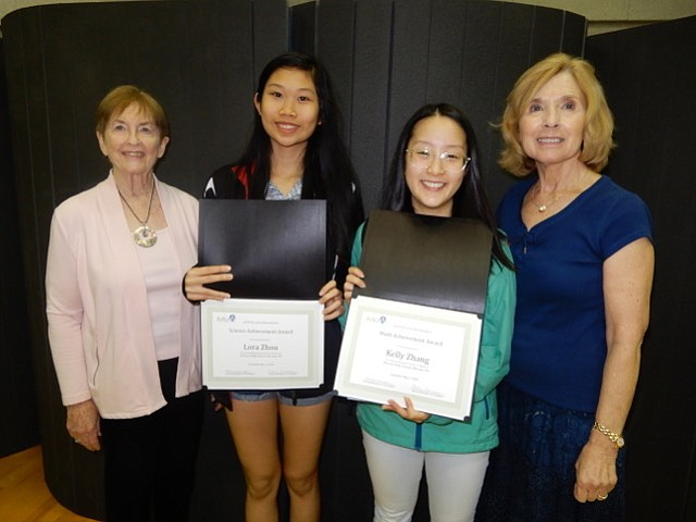 Lora Zhou, second from left, and Kelly Zhang, second from right, juniors at McLean High School are shown receiving their academic achievement awards from the McLean Area Branch of AAUW. The awards were presented by Caroline Pickens, far left, AAUW of VA Northern District Co-Representative, and Myrtle Hendricks-Corrales, far right, branch liaison for McLean High School.
