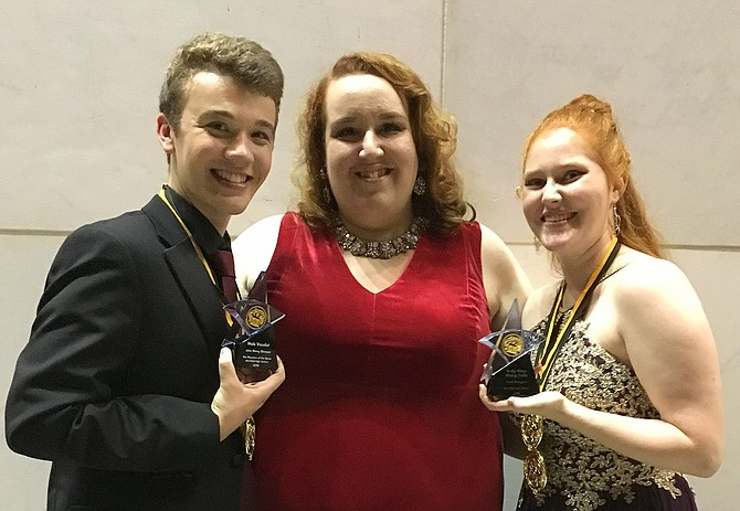 "For Westfield's production of ""The Phantom of the Opera,"" John Henry Stamper – acting in the title role – captured the Male Vocalist award, and Sarah Bourgeois was honored as Rising Critic. They are congratulated by Westfield Theater Director Rachel Harrington Johnson. At the Gala, Stamper and Molly Van Trees performed the show's title song onstage and received the evening's only standing ovation."