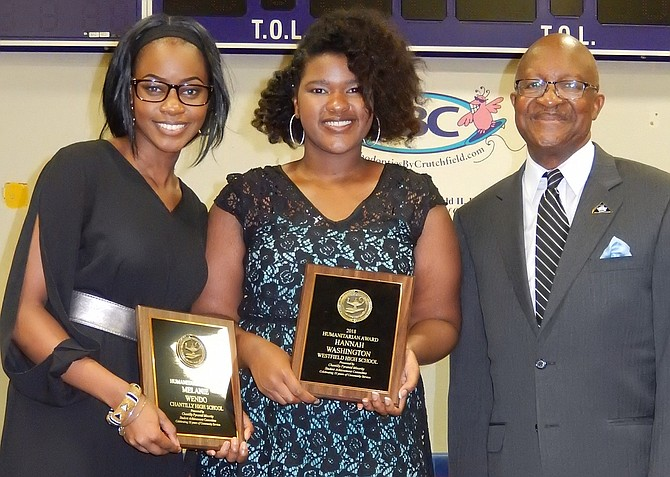 Among the high-school Humanitarian Award winners are (from left) Melanie Wendo and Hannah Washington with Johnny Nelson. (Not pictured are Mya Baptiste, Derrian Brown and Tagwa Shammet).