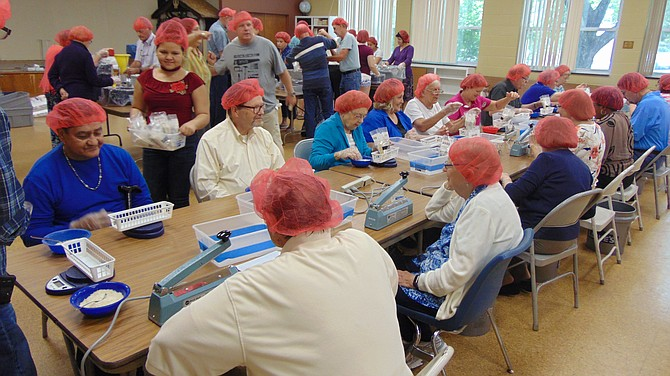 About 70 volunteers helped package boxes with rice and soy for a third-world country at Wesley United Methodist Church.