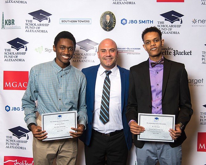 T.C. Williams High School principal Peter Balas (center) with students Zachary Hunter (left), recipient of the Peter Balas Scholarship, and Abel Argaw (right), recipient of the Suzanne Maxey Scholarship. Maxey was principal of T.C. Williams from 2010 to 2015.
