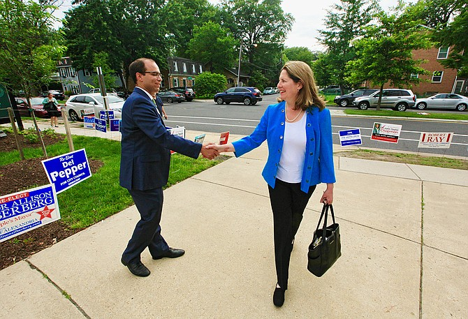 Mayor Allison Silberberg and her opponent Vice Mayor Justin Wilson shake hands in passing at the Mount Vernon Recreation Center just before the polls closed on the day of the Democratic primary, June 12.