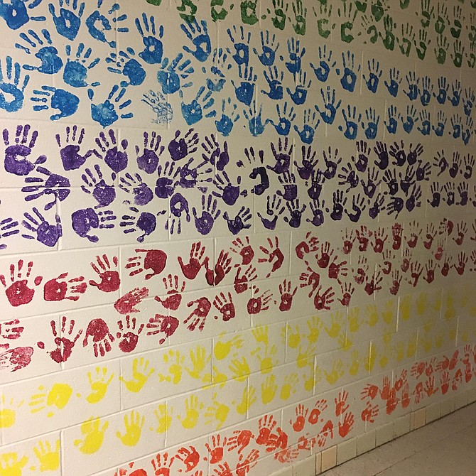 Students from each grade level left their hand prints on the wall at Potomac Elementary School.