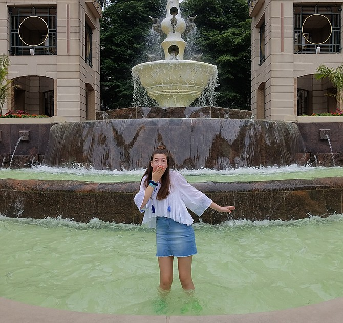 Sissy Sheridan pictured in the Reston Town Center Fountain.