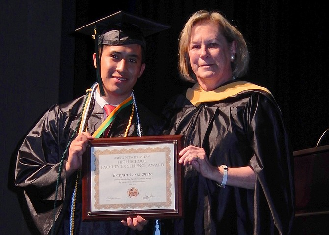Brayan Perez Brito receives the Faculty Award from counselor Ellen Fay.