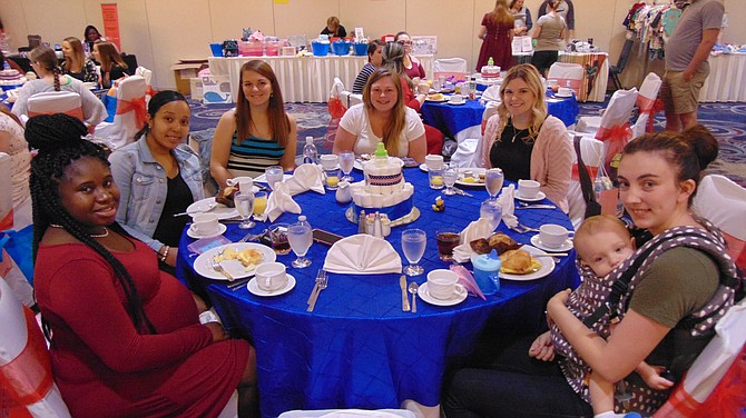 Some of the 50 women participating in the Baby Shower sponsored by Operation Homefront at the Springfield Hilton.