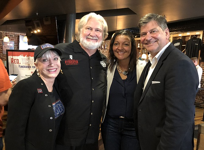 Elaine Rogers, left, president and CEO of USO Metropolitan Washington-Baltimore, joins celebrity chef Myron Mixon and Giant Food executive Felis Andrade and division president Gordon Reid June 19 at Myron Mixon's Pitmaster BBQ Restaurant in Alexandria for the 2nd annual Red, White and BBQ fundraiser to help aid American troops.
