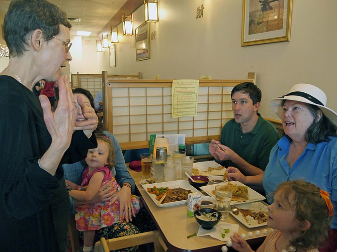 """Rosie Gordon-Mochizuki chats with three generations of the Almand family who have gathered at Sushi Zen on June 20 to celebrate the 20th fundraiser of the year. This fundraiser is for Arlington Neighborhood Village (ANV). Elizabeth Haire Almand explains that she and her son Peter Reijmers came from Charlottesville to visit her daughter and two grandchildren, Arden and Emily, in Arlington. She says when she asked her son to choose where to eat, """"the answer was immediately Sushi Zen."""""""