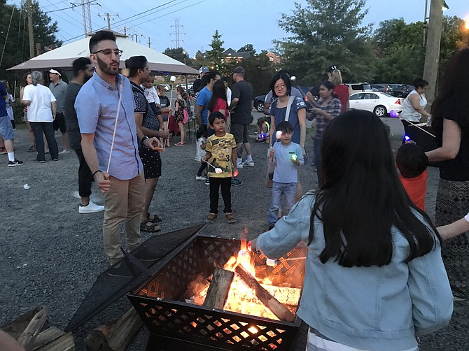 Families enjoyed making free S'Mores over the fire pit at Arts Herndon's 2018 Light Festival powered by EOTH @ eotherize.