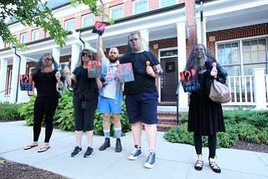 Protestors with the DC chapter of Gays Against Guns protest outside of the home of U.S. Department of Homeland Security Secretary Kirstjen Nielsen, June 26.