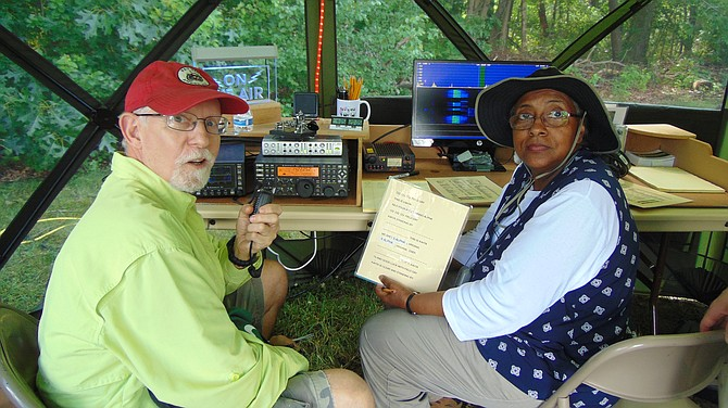 Gary Mannering of Falls Church (KJ4PZP) and Rebecca Cody of Herndon (KM4RDS) at the Get on the Air Tent.