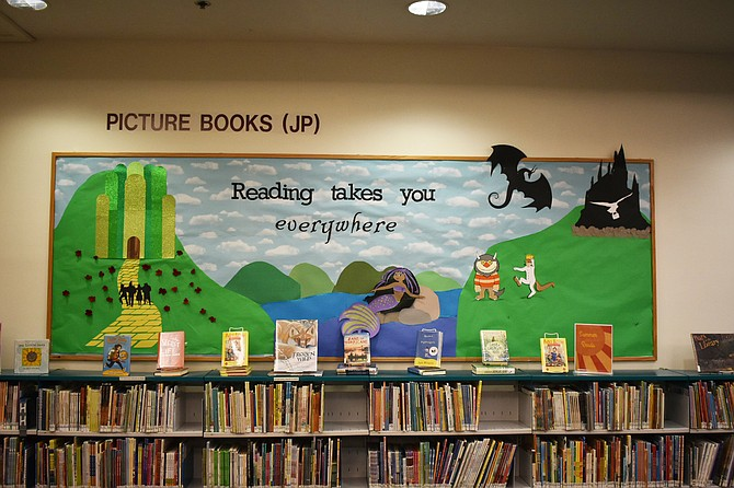 "This bulletin board at Patrick Henry Library displays the summer reading program theme: ""Reading takes you everywhere."""