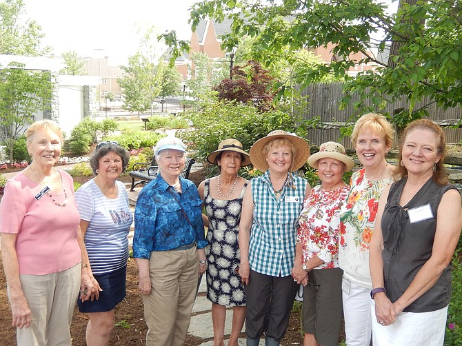 In Kitty Pozer's garden are Fairfax Ferns Garden Club members (from left) Hildie Carney, Ginny Warren, Mary Ellen Alden, Mary Villa McLaughlin, Karin Rindal, Mariann Kowalski, President Eileen Tumelty and Justine Harris.