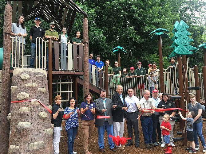 From left: Cindy Walsh, Director of Resource Management; Isabel Villarroel, Project Manager; Aimee Vosper, Deputy Director; Mike Thompson, Park Authority Board; State Sen. David Marsden (D-37); Bill McCabe, Legislative Aide; Mike McCaffrey, Park Manager; and Michelle Alexander, Assistant Manager with volunteers and park visitors cutting the ribbon for the new playground.