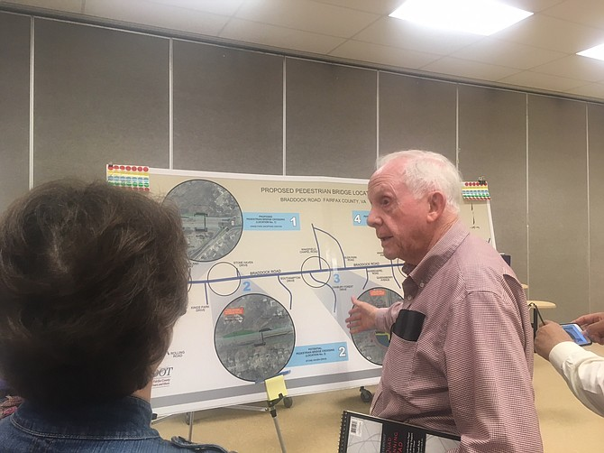 Long-time resident Bill Brennan looks at the plans for the intersection near his house.