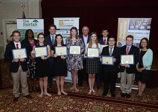 Scholarship recipients are congratulated by chamber leadership. From left: Michael Krause, Thomas Jefferson High School; Sonja Caison, Chamber President; Danielle Thomas, West Potomac High School; Scott Stroh III, Chamber Chairman; Alyssa Thomas, West Potomac High School; Emily Boehm, Mount Vernon High School; Michael Bennett, Ourisman; Emily Riffer, Lee High School; Alex Morin, South County High School; Christopher Truong, Lee High School; Ian Peverell, Mount Vernon High School; and state Del. Kathy Tran.