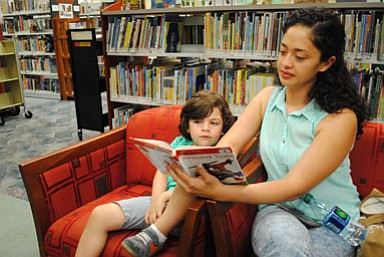 """It's good for kids to come and read the books here because they are on their iPads and televisions a lot at home. I like him to come here to interact with the other kids,"" said Leydia Reyes, Alexandria resident and nanny of four-year-old Constantino. ""We always find what we are looking for here. As long as it's about dinosaurs, he's happy."""