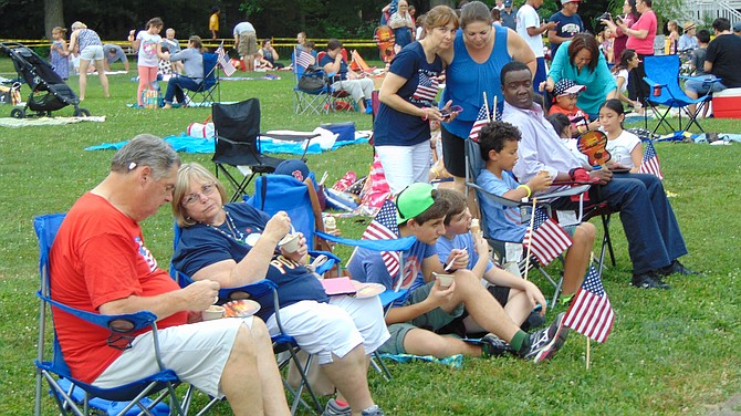 The crowd of the McLean Fourth of July celebration held at Churchill  Road Elementary School in McLean. The event was sponsored by the McLean Community Center.