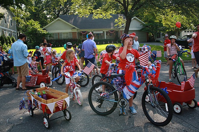 Kids on bikes led this parade in the Marlan Forest parade.