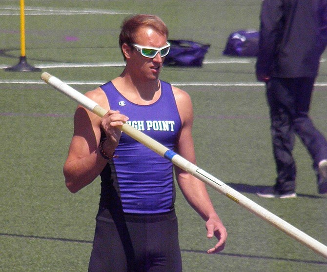Pole vaulter Austin Miller prepares to run, plant the flexible pole and when it bends nearly 90 degrees, it will recoil, unleashing the power to propel him up and over the bar, soaring a hopeful 18 feet plus at the High Point University, Big South Conference Finals.