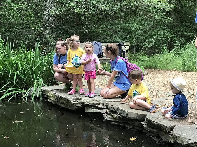 Children at the Walker Nature Center learn about the world around them through hands-on activities.