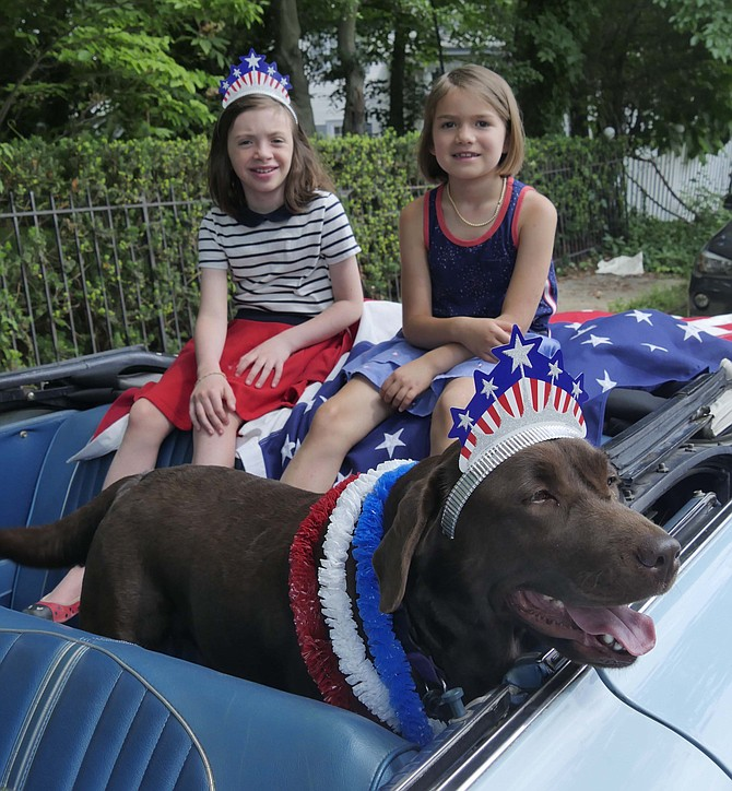 Eight-year-old Margaret Torrey, seven-year-old Lila Sobba and English lab, Rosie, queue up in Alan Sobba's 1964 baby blue Galaxie 500 for the Lyon Village 4th of July parade on Wednesday.