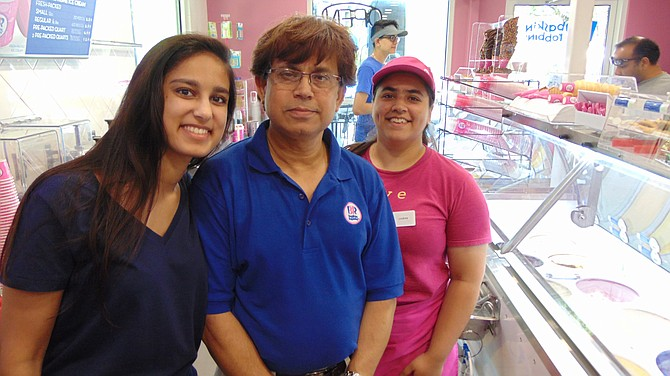 (From left): Syeda Akther; Syed Ahmed, owner of Baskin Robbins; and Lindsey Sikand at the grand opening of the Baskin Robbins.