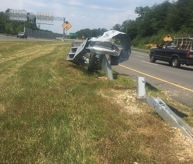 On the Fairfax County Parkway, this guardrail remains a tangle of steel, but there are traffic cones on site to warn motorists. As this story went to print, this guardrail wreckage was repaired.
