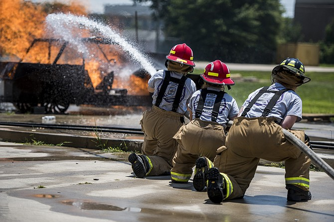 Participants in the the Fairfax County Fire and Rescue Department's Girls Fire and Rescue Academy used their newly acquired skills to respond to simulated emergencies.
