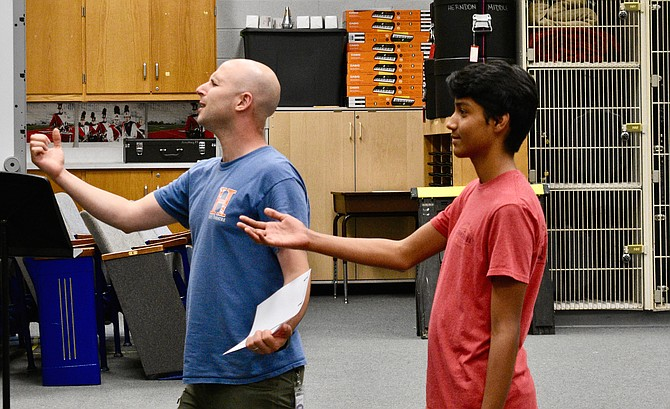 Director Raphael Schklowsky coaches Herndon High's Ankit Poudel on his lead role as Prince Eric.