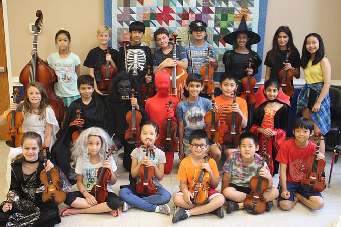 Group photo of the musicians at Summer Strings. All rising fourth through sixth grade musicians attend Spring Hill Elementary School.