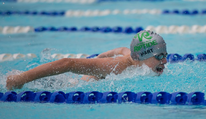 Michael Hart swam butterfly and placed first in breaststroke.