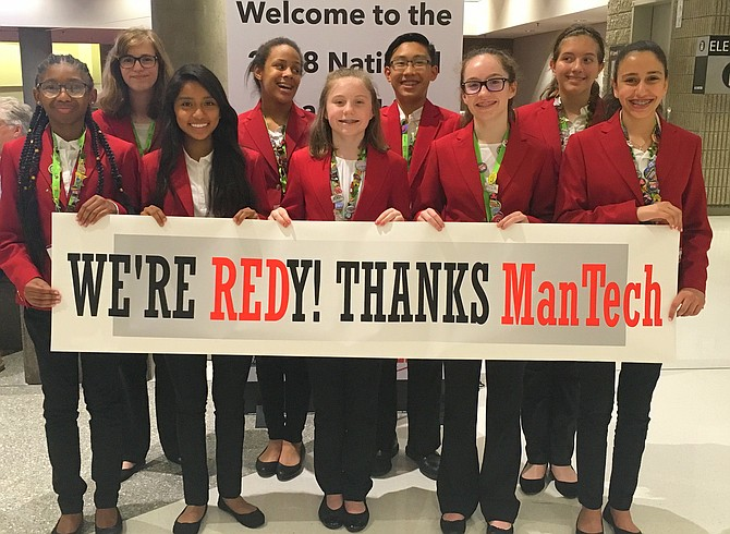 City of Fairfax FCCLA members, from both Lanier Middle and Fairfax High schools, with a banner thanking their sponsor, ManTech. (From left) are Kayleigh Williams, Juli Luckabaugh, Miranda Cespedes, Naomi Daniels, Riley Sarber, Yale Kim, Emily Sarber, Hope Peters and Hana Ismail. (Not pictured: Diego Santiago).