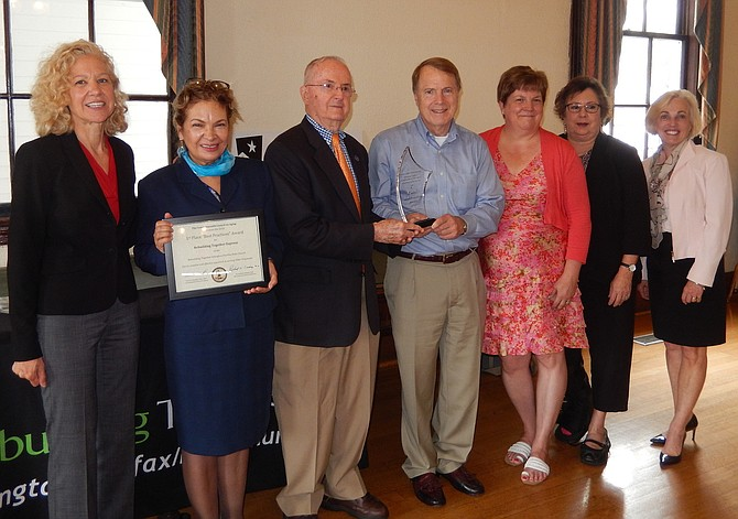 Rebuilding Together is honored: From left are Patti Klein, Diana Paguaga, Richard Lindsay, Mayor David Meyer, Amy Marschean, Linda Bufano and Caroline Blakely.