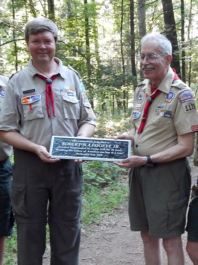 New Scoutmaster Steve Englund presents the Camp Leggett dedication plaque to retired Scoutmaster Bob Leggett.