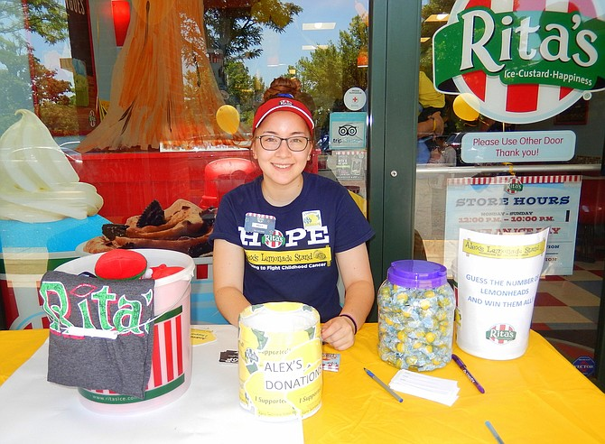 Fairfax High grad Kelly Salguero collects donations outside Rita's Italian Ice.