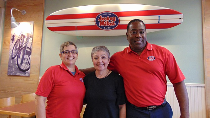 Jersey Mike's owners Tracey (left) and Maurice Jennings, with Linda Patterson of Lorton Community Action Center.