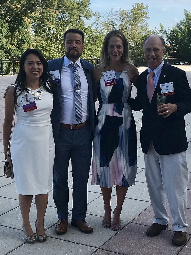 Alexandria Rotary Club president Paul Anderson, right, poses for a photo with the organization's 40 Under 40 honorees July 19 at United Way Worldwide headquarters. With him from left are Anh Nguyen, Ru Toyama and Christine Friedberg.