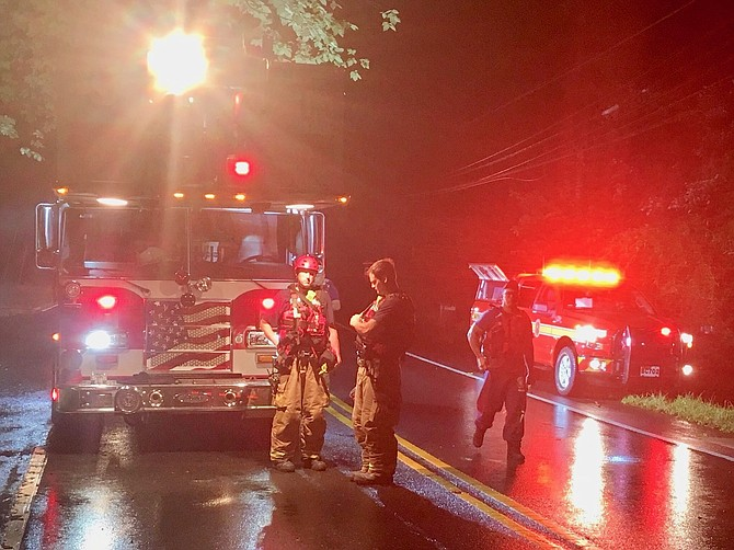The county's Swift Water Rescue Team aided occupants in a car trapped by high water on Bradley Boulevard Aug. 1.