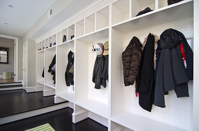 This mudroom designed by Allie Mann of Case Design/Remodeling features a cubbie for each family member.
