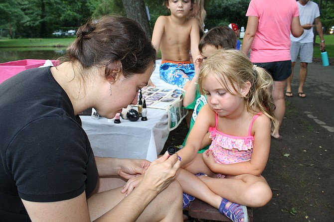 Callahan O'Brien gets a tattoo on National Night Out from tattoo artist Pamela Outwin.