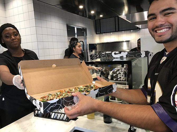 """This is the best pizza ever,"" said Ricardo Lopez, who works in Reston. ""The garlic ricotta sauce is really good; one of my favs. I've convinced my co-workers to come.  This is my third pizza; I'm going to have to hit the gym."""